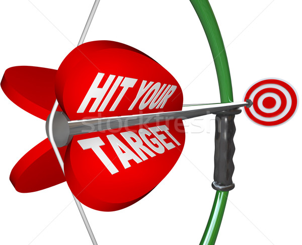 Hit Your Target - Bow and Arrow Aimed at Bulls Eye Stock photo © iqoncept