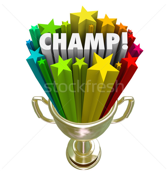 Stock photo: Champ Gold Trophy Award Winner Stars Fireworks