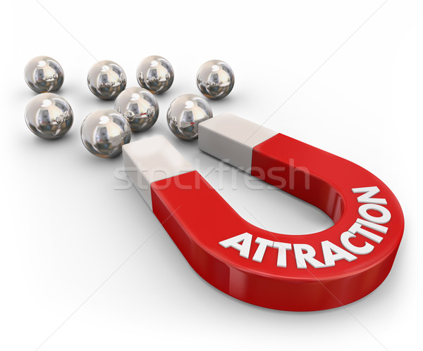 Attraction Red Magnet Pulling Drawing Metal Ball Bearings Stock photo © iqoncept