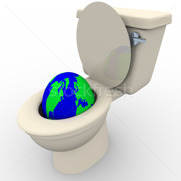 Flushing Earth Down the Toilet Stock photo © iqoncept