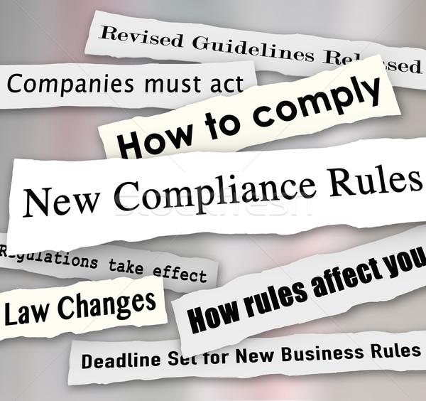Stock photo: Compliance Headlines Newspaper Torn New Business Regulations Com