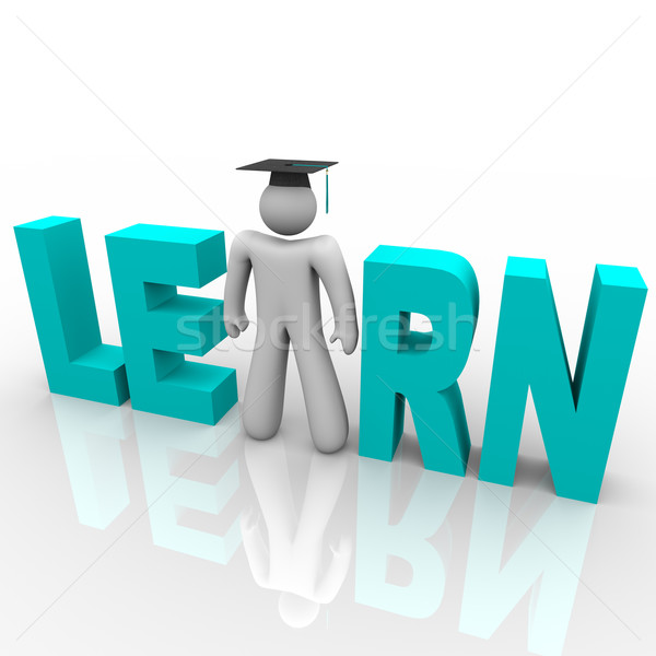 Learn - Man in Word with Graduation Cap Stock photo © iqoncept