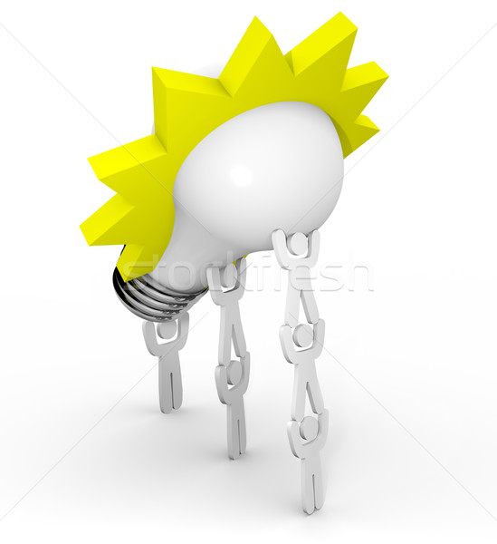 Innovation - Team Lifting Light Bulb Stock photo © iqoncept