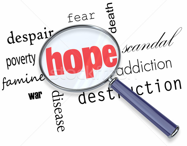 Searching for Hope in Bad News - Magnifying Glass Stock photo © iqoncept