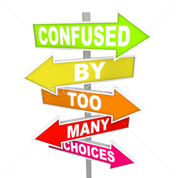 Stock photo: Confused by Too Many Choices Arrow Street Signs