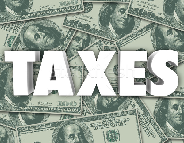 Taxes Word Hundred Dollar Bills Money Background Stock photo © iqoncept