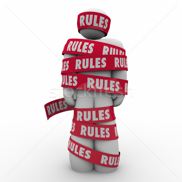 Rules Man Wrapped Tape Regulation Compliance Follow Laws Guidanc Stock photo © iqoncept