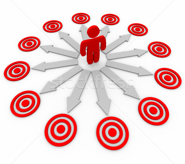 Many Opportunities are Targeted - Man and Arrows Stock photo © iqoncept