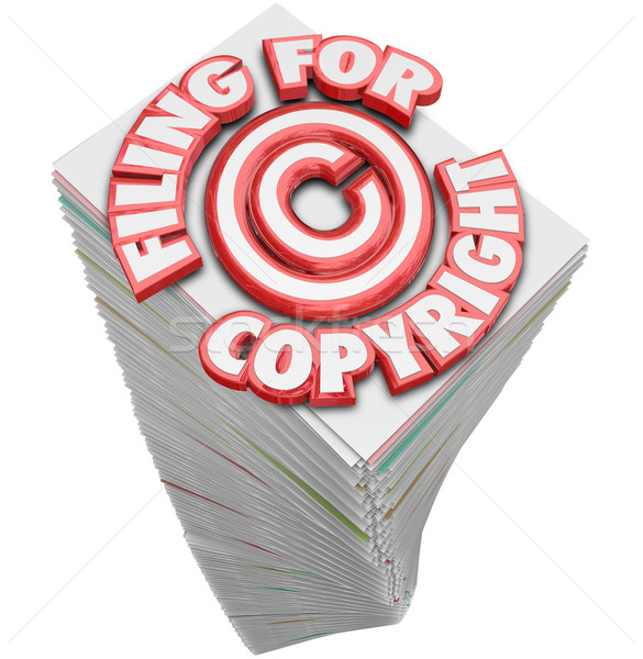 Filing for Copyright Protection Symbol on Tall Stack of Papers D Stock photo © iqoncept