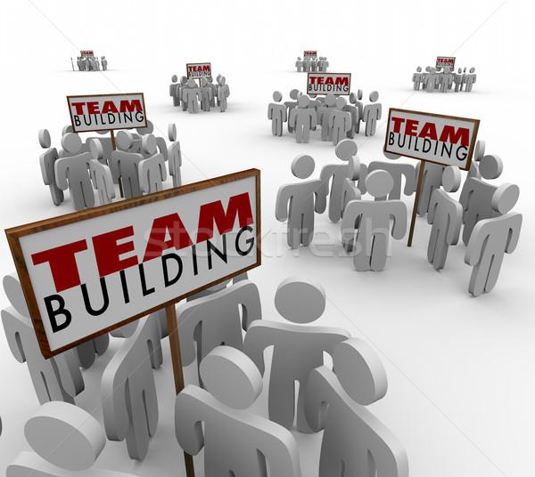 Team building persone in giro segni riunione lavoro di squadra Foto d'archivio © iqoncept