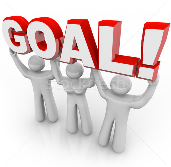 Goal Word Lifted by Cheerleader Team Hoping for Win and Success Stock photo © iqoncept