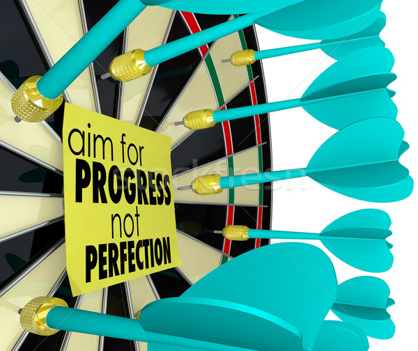 Aim for Progress Not Perfection Dart Board Improvement Stock photo © iqoncept