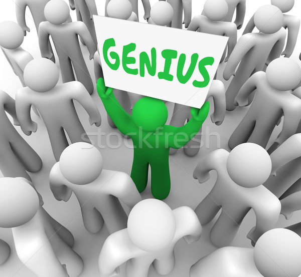 Genius Brilliant Person Holding Sign Smart Intelligent Stock photo © iqoncept