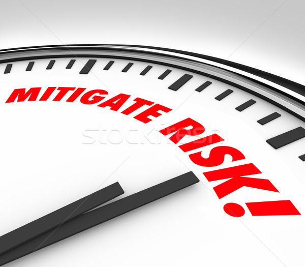 Mitigate Risk Clock Time to Reduce Danger Hazard Liability Stock photo © iqoncept