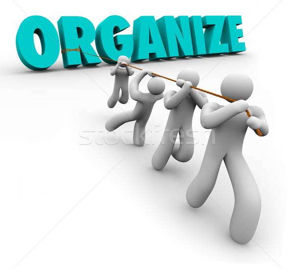Organize Word Pulled by Team Workers Union Working Together Stock photo © iqoncept