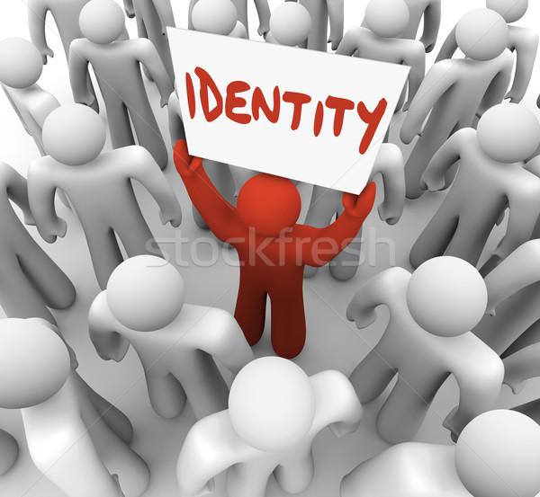 Identity Man Holding Sign Unique Brand Status Awareness Stock photo © iqoncept