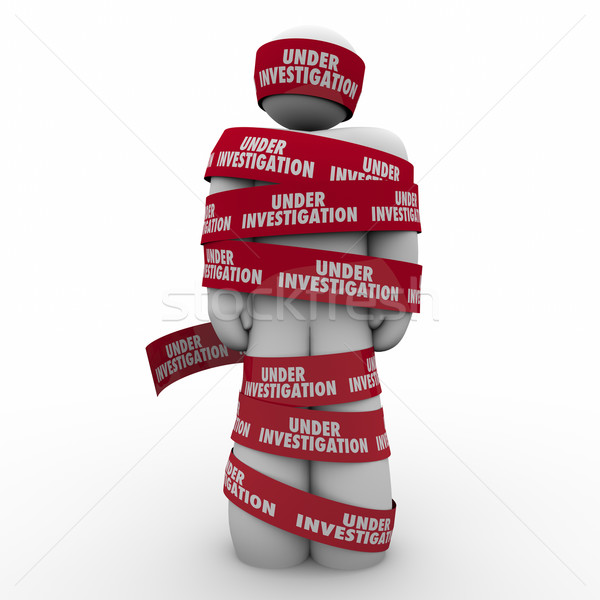 Stock photo: Under Investigation Words Red Tape Around Man Crime Suspect Arre