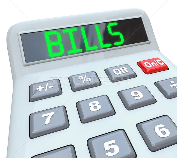 Bills - Word on Calculator for Payment of Expenses Stock photo © iqoncept