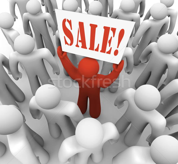Stock photo: Person Holding Sale Sign in Crowd Advertising Savings