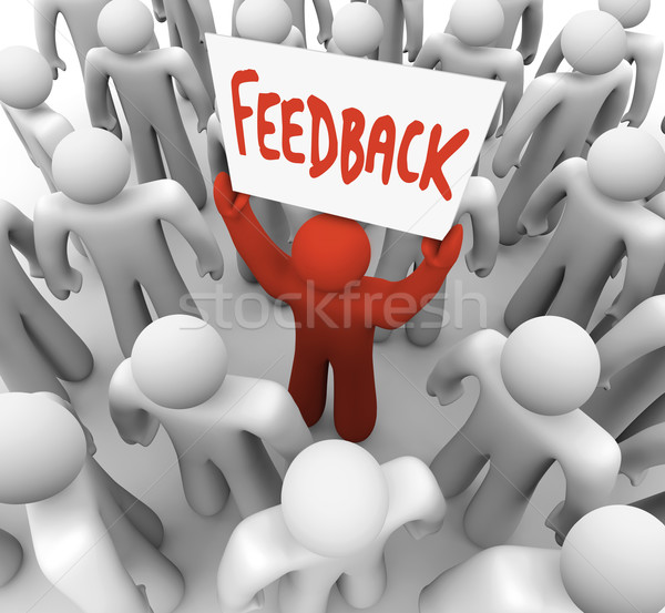 Feedback Man Holding Sign in Crowd Sharing Opinion Stock photo © iqoncept