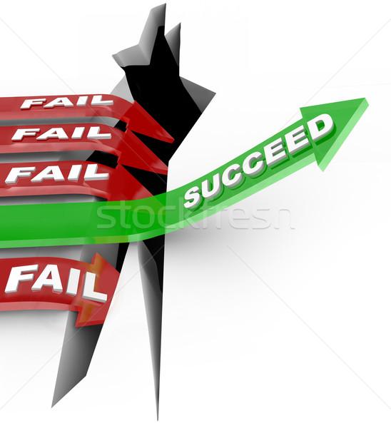 Success Arrow Jumps Chasm Failure Falls Into Hole Stock photo © iqoncept
