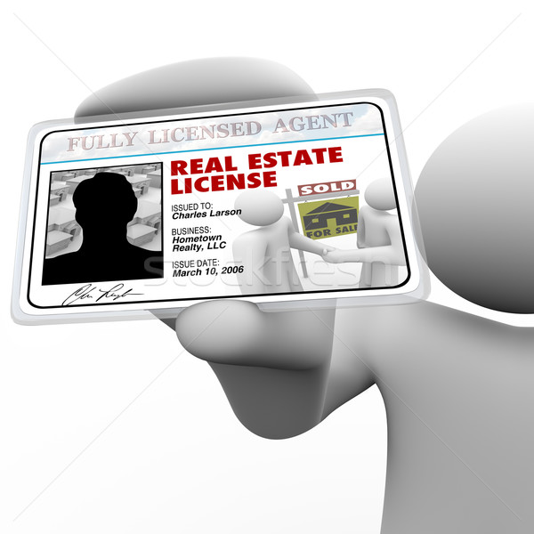 Real Estate Agent Holding License Laminated Identification Card Stock photo © iqoncept