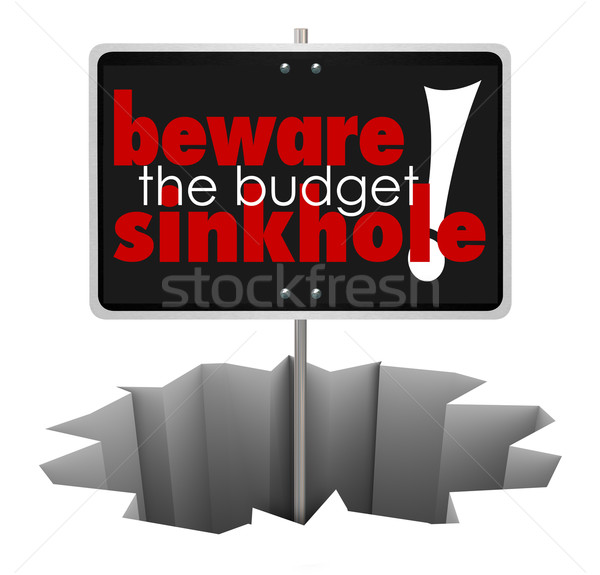 Beware the Budget Sinkhole Sign Hole Money Trouble Bankruptcy Stock photo © iqoncept