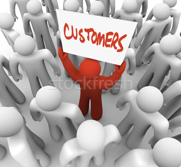 Person Holding Customers Sign in Crowd Stock photo © iqoncept
