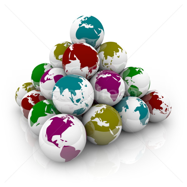 Pyramid of Colorful Planet Earths Stock photo © iqoncept