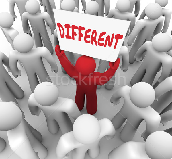 Different Word Sign Unique Man Standing Out in Crowd of People Stock photo © iqoncept