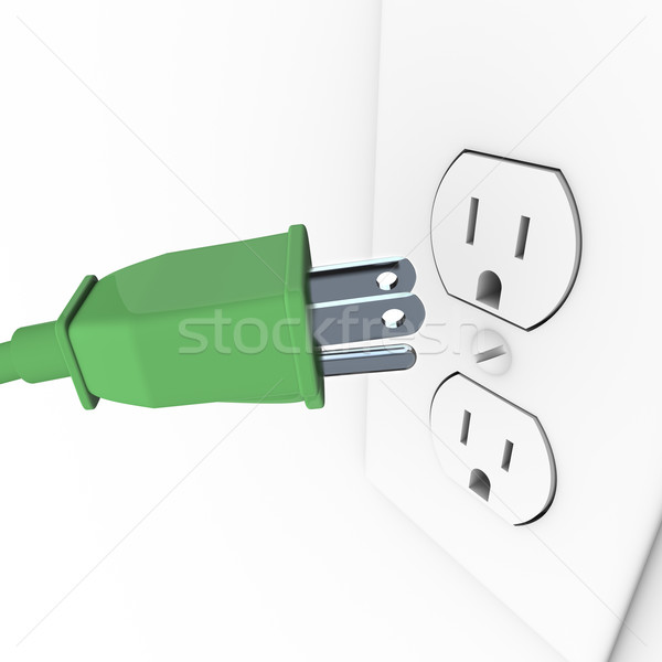 Green Electrical Plug into Wall Outlet Stock photo © iqoncept