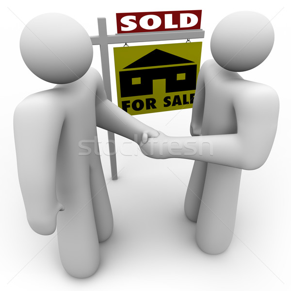 Buyer and Seller Handshake - For Sale Sign Stock photo © iqoncept