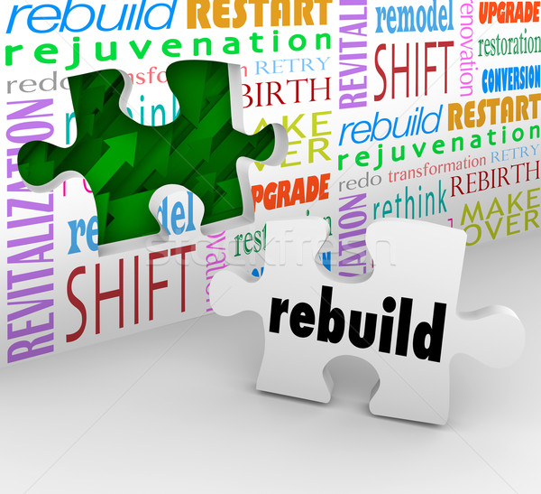Rebuild Word Puzzle Piece Wall Reinvent New Start Stock photo © iqoncept
