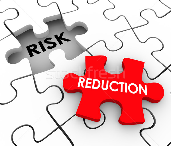 Stock photo: Risk Reduction Puzzle Pieces Mitigate Dangerous Behavior Increas