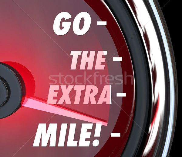 Stock photo: Go the Extra Mile Speedometer Words Further Extended Driving Eff