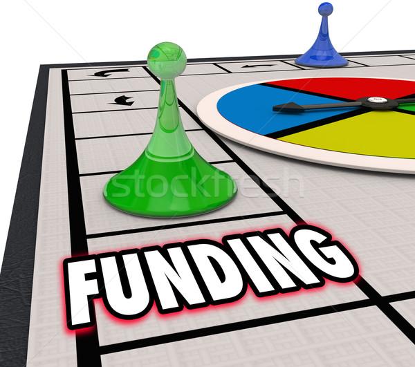 Pénzügyi beruházás pénz erőforrások társasjáték szó Stock fotó © iqoncept