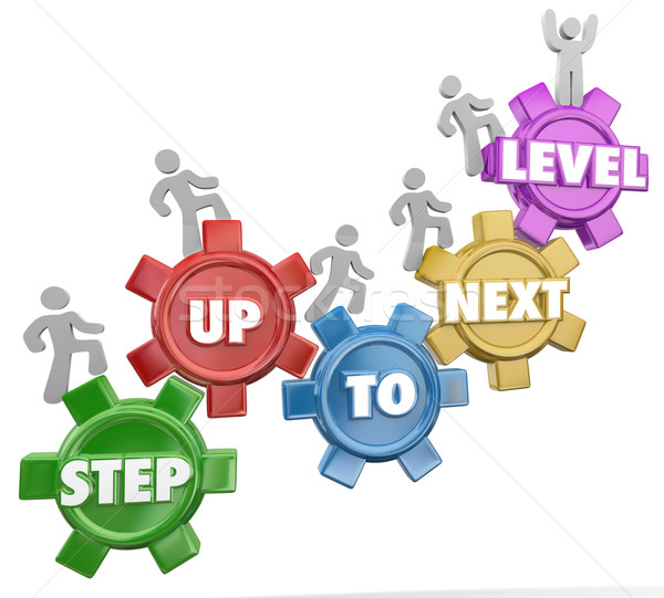 Step Up to Next Level Gear Marchers Rising Success Achievement Stock photo © iqoncept
