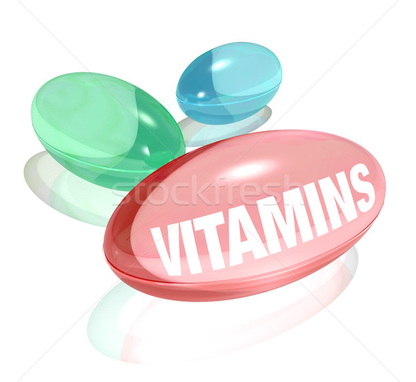 Vitamins on White Background and Word on Capsule Stock photo © iqoncept