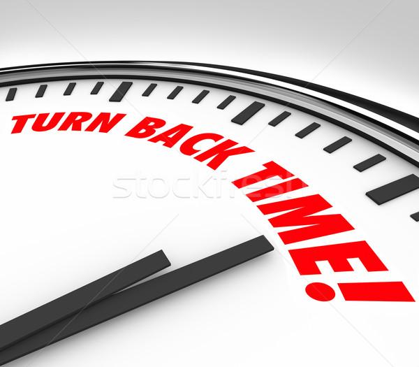 Obracać powrót czasu zegar starzenie się słowa Zdjęcia stock © iqoncept