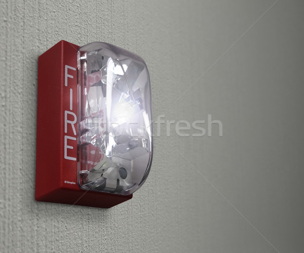 Fire Drill on Wall Alarm Emergency Stock photo © iqoncept