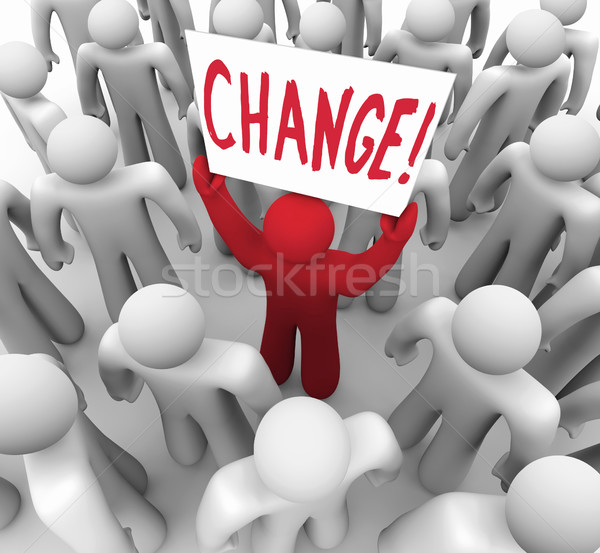Change - Person Holding Sign in Crowd Stock photo © iqoncept