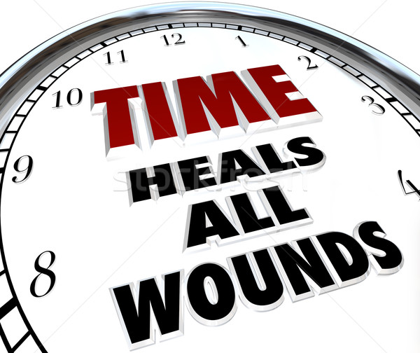 Time Heals All Wounds Clock Saying - Forgiveness of Disputes Stock photo © iqoncept