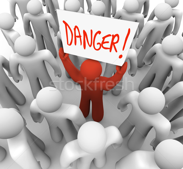 Danger - Person Holding Sign to Warn or Alert Others Stock photo © iqoncept