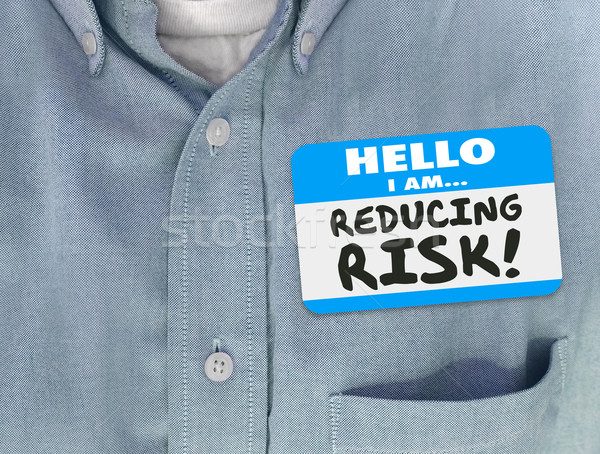 Stock photo: Reducing Risk Nametag Sticker Shirt Mitigator Decrease Danger