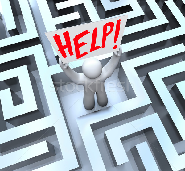 Person in Labyrinth Maze Holding Help Sign Stock photo © iqoncept