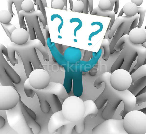 Person Holding Question Mark Sign in Crowd Stock photo © iqoncept