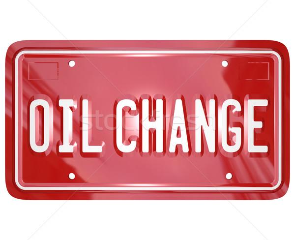 Óleo mudar vermelho carro placa mecânico Foto stock © iqoncept