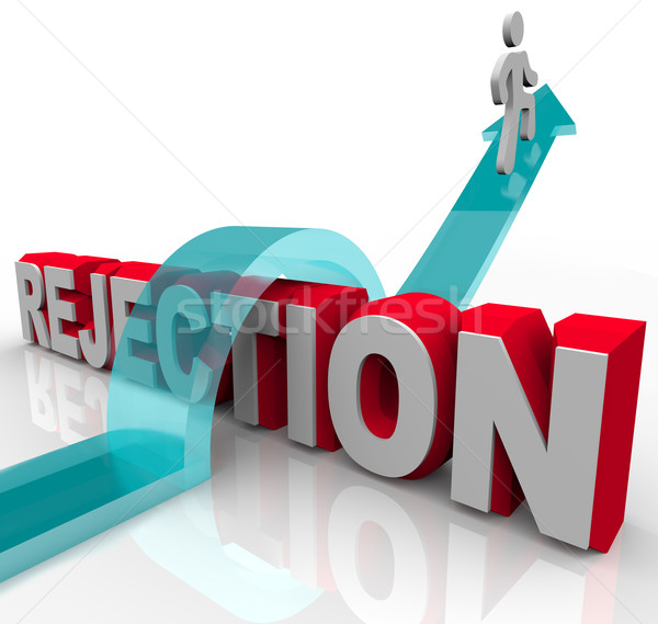 Getting Over Rejection - Arrow Jumping Over Word Stock photo © iqoncept