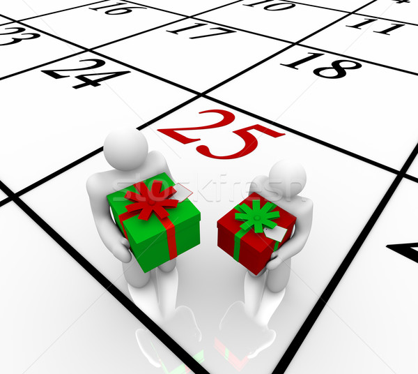 Christmas Calendar -  People Exchanging Gifts Stock photo © iqoncept