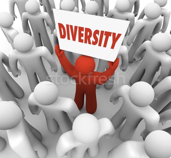 Diversity Word Different Unique Man Holding Sign Stock photo © iqoncept